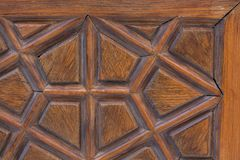 Arte do otomano com testes padrões geométricos na madeira Foto de Stock