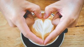 Arte e mão quentes do café Imagem de Stock Royalty Free