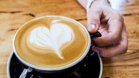Arte e mão quentes do café Imagem de Stock