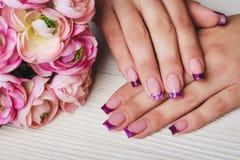 Arte francesa do prego na cor roxa Foto de Stock