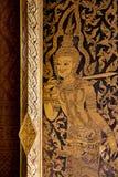 Arte mural tailandés en ventana Foto de archivo