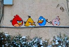 Arte o graffiti della via con gli uccelli arrabbiati dall'artista non identificato Immagini Stock Libere da Diritti