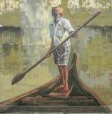 Arte público de la calle en Georgetown 'viejo hombre con una paleta en un barco ' imágenes de archivo libres de regalías