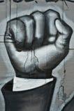 Arte urbana - pugno rivoluzionario Immagini Stock Libere da Diritti