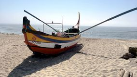 Arte Xavega typical boat. ESPINHO, PORTUGAL - JULY 16, 2017: Arte Xavega typical portuguese old fishing boat on the beach in Paramos, Portugal stock video footage