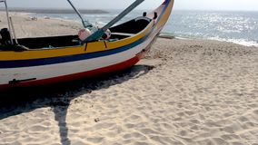 Arte Xavega typical boat. Espinho, Portugal - July 16, 2017: Arte Xavega typical portuguese old fishing boat on the beach in Paramos, Portugal stock footage