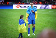 Artem Fedetskiy and his son react after FC Dnipro loses the Fina Royalty Free Stock Photos