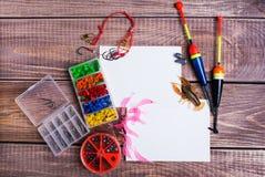 Artes de pesca en los tableros de madera foto de archivo libre de regalías