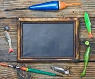 Artes de pesca y pizarra Imágenes de archivo libres de regalías