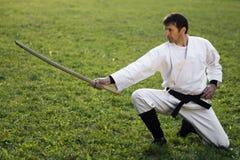 Artes marciales con la espada de madera Imágenes de archivo libres de regalías