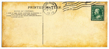 Artes of Postage. The mottled and stained back-side of an old postcard from the 1910 royalty free stock photo