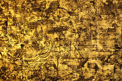 Artes tailandeses en la pared de madera Foto de archivo libre de regalías