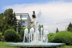 Artesian well and the statue of Radu Negru Basarab. A view with an artesian well and the statue of Radu Negru Basarab from Campulung, Romania Royalty Free Stock Image
