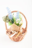 Artficial flower in the basket Royalty Free Stock Photos