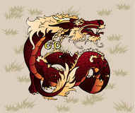 Artful brown earth Asian dragon on grass. Artful brown earth Asian Chinese dragon against a brown grass Royalty Free Stock Images