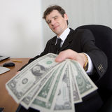 The artful businessman and money Royalty Free Stock Image
