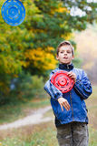 Artful guy with two Frisbee on the background of autumn forest Royalty Free Stock Photography