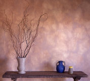 Artful Interior. Faux finished wall with rustic table and artisitc objects. Home interior Stock Photography