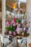 Artfully arranged Easter arrangement stands in the foyer of a hotel stock photography