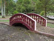 Artfully Designed Stone Bridge on Pebbled Foot-path in Public Park Stock Image