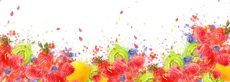 Artfully and lovingly designed fruit explosion banner with raspberries, blackberries, strawberries, kiwis, lemon and. Great photo montage with explanting berries royalty free stock images