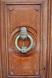 Artfully made door element. The picture was taken in Spain, Reus. The picture shows the door handle cleverly made of copper Royalty Free Stock Photography