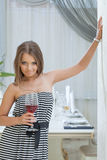 Artfully smiling young girl posing in restaurant Stock Photo