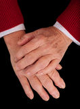 Arthritic Hands. Of a senior woman on a black background Stock Image