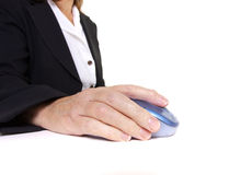 Arthritic worker. Older senior business woman's arthritic hand with knobbly finger operating mouse Stock Image