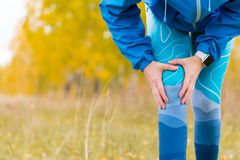 Arthritis athlete. Injuries - sports running knee injury woman. Closeup of leg, and knee outdoors royalty free stock image