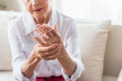 Elderly female is expressing pain Royalty Free Stock Photos