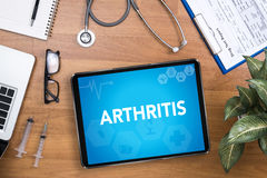 ARTHRITIS. Professional doctor use computer and medical equipment all around, desktop top view stock images