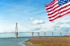 Arthur Ravenel Jr. Bridge at Charleston, South Carolina, with star spangled banner in the foreground Stock Images
