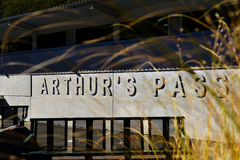 Arthur`s Pass Sign. On a wall, New Zealand Stock Photography