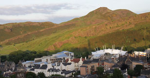 Arthurs Seat and Holyrood. View of Arthur's Seat and Edinburgh cityscape at dusk Stock Image