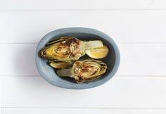 Artichauts et citrons du plat Ce produit a une des capacités antioxydantes les plus élevées Image libre de droits