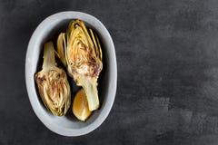 Artichauts et citrons du plat Ce produit a une des capacités antioxydantes les plus élevées Tableau comme fond Photos libres de droits