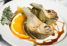 Artichoke. Closeup view of grilled artichoke on a plate royalty free stock photos