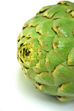 Artichoke. In the US, whole Globe Artichokes are most frequently prepared for cooking by removing all but 5–10 mm or so of the stem, and (optionally) cutting Stock Photography