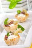 Artichoke, anchovy and cream cheese canapes Stock Images
