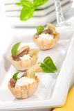 Artichoke, anchovy and cream cheese canapes Stock Photography