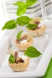Artichoke, anchovy and cream cheese canapes Royalty Free Stock Images