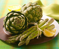 Artichoke and asparagus Stock Images