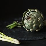 Artichoke at black background stock photo