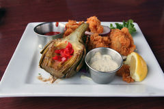 Artichoke and calamari appetizer. Artfully presented appetizer of artichoke and calamari Stock Photo