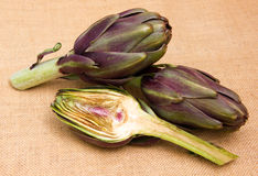 Artichoke cut in half on placemat Royalty Free Stock Photography