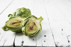 Artichoke cut in half on white with copy space Royalty Free Stock Photos