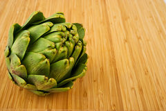 Artichoke on Cutting Board Royalty Free Stock Photo