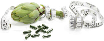 Artichoke with dietary supplement Royalty Free Stock Photos