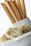 Artichoke Hearts and Bread Sticks. Healthy appetizer consisting of herbed artichoke hearts with bread sticks Stock Photos